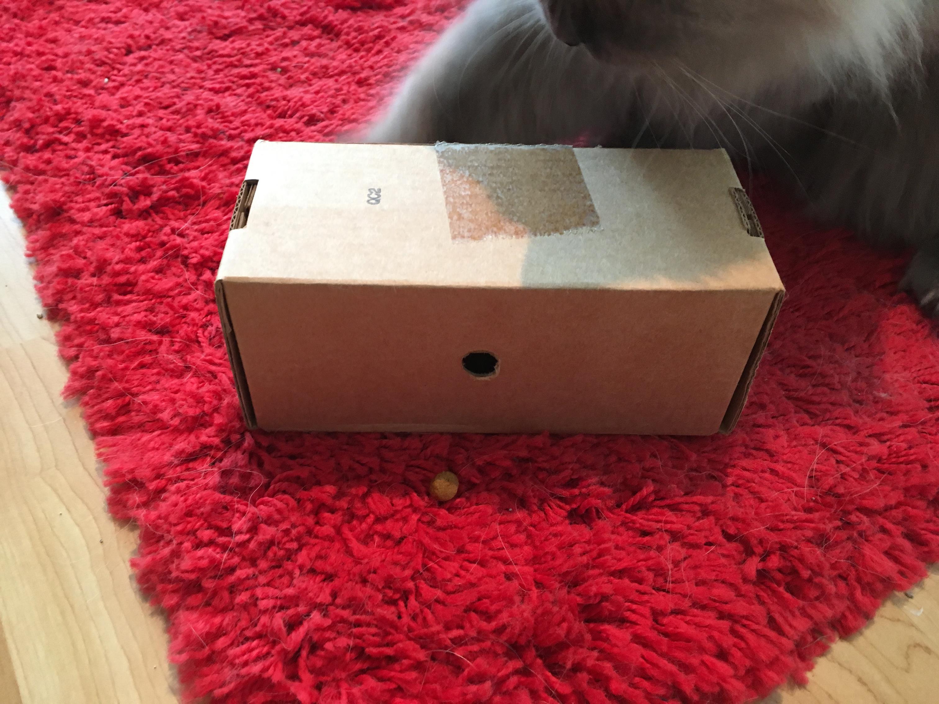 1. Poke hole in a cardboard box.