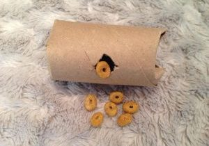 A toilet paper roll food puzzle.